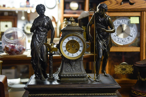 BEN MIKESELL | THE GOSHEN NEWS<br /> A clock in need of repair sits on display in Elias Martin's workshop on C.R. 40 in Goshen.