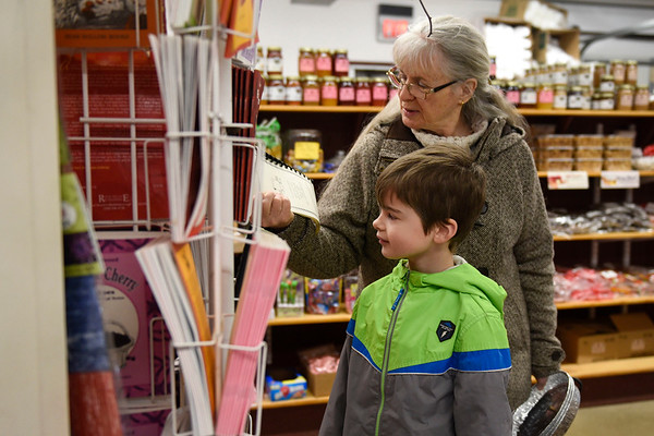BEN MIKESELL | THE GOSHEN NEWS<br /> Colby Applegate, 7, Goshen, peruses a garage sale with his grandmother Sylvia Kutz, visiting from Illinois, Thursday morning at Kercher's Sunrise Orchards. The garage sale, which started Thursday, will run until Saturday.