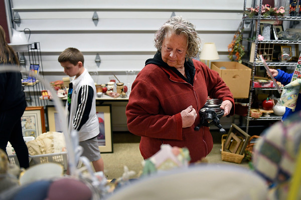 BEN MIKESELL | THE GOSHEN NEWS<br /> Fran Scherer, Goshen, peruses through the displays Thursday morning during a garage sale at Kercher's Sunrise Orchards. The garage sale, which started Thursday, will run until Saturday.
