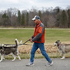 BEN MIKESELL | THE GOSHEN NEWS<br /> Ron Geyer, Dunlap, walks his three Siberian huskies Paxson, Kiana and Kobuk Friday afternoon around Ox Bow County Park. The park board will unveil its fie-year master plan for the parks Monday.