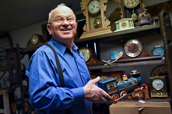 BEN MIKESELL | THE GOSHEN NEWS<br /> Elias Martin works in his shop Thursday afternoon at his home on C.R. 40. Martin has worked as a clock repairman for 20 years in retirement.