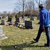 BEN MIKESELL | THE GOSHEN NEWS<br /> Director of cemeteries Burton Matteson looks for areas that need cleaned during Tuesday's spring clean up at Violett Cemetery. Matteson, the sexton at Violett Cemetery, is responsible for maintaining the overall appearance of the grounds while respecting the different ways families decorate memorials.