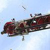 SHEILA SELMAN | THE GOSHEN NEWS<br /> Elkhart Township firefighters throw candy from the top of an ladder truck to teenagers at Grace Community Church in Goshen Sunday afternoon.