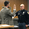 JOHN KLINE | THE GOSHEN NEWS<br /> Goshen Mayor Jeremy Stutsman, left, conducts the swearing-in ceremony for Nicolas M. Kauffman following his promotion from the rank of patrol officer to the rank of sergeant with the Goshen Police Department during Monday's Goshen Board of Public Works and Safety meeting.