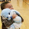 SHEILA SELMAN | THE GOSHEN NEWS<br /> Harlan Wakeland hugs the bunny he won at the New Paris Lions Easter egg hunt at New Paris Elementary School SAturday.