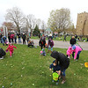 AIMEE AMBROSE | THE GOSHEN NEWS <br /> Children and their families dash for eggs at the start of the Middlebury Township Fire Department's annual Easter egg hunt at Memorial Park in Middlebury Saturday. A couple hundred people participated, and the hunt was over in about three minutes, Capt. Scott Dreamer estimated.