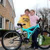 AIMEE AMBROSE | THE GOSHEN NEWS <br /> (from the left) Siblings Max and Ayuh Sharp, Warsaw, stand as co-winners of the girl's bicycle following the Middlebury Township Fire Department's annual Easter egg hunt at Memorial Park in Middlebury Sasturday.