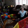 BEN MIKESELL | THE GOSHEN NEWS<br /> Judy Spicher sits in her living room Tuesday afternoon in her home in Nappanee. Because of the dirt released by the neighboring Tri State Crush plant, Spicher prefers to have her kids play inside.
