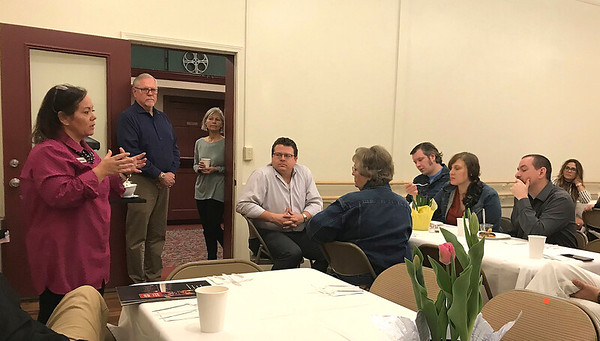 JOHN KLINE | THE GOSHEN NEWS<br /> Joanna King, a downtown business owner and co-director of the $5.2 million Goshen Theater fundraising campaign, left, provides an update on the current status of the campaign during a stakeholder breakfast at the theater Wednesday morning.