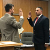 JOHN KLINE | THE GOSHEN NEWS<br /> Goshen Mayor Jeremy Stutsman, left, conducts the swearing-in ceremony for Warren C. O'Neal III following his hiring as a probationary patrol officer with the Goshen Police Department during Monday's Goshen Board of Public Works and Safety meeting.