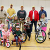 SHEILA SELMAN | THE GOSHEN NEWS<br /> Winners of the bicycle drawing are pictured with members of the New Paris Lions Club following the Lions-sponsored Easter egg hunt at New Paris Elementary School Saturday. In front are Ellianna Hunt, left, and Barrett Werner. In the second row, from left, are Cole Prater, Izabella Hammond, Madison Levitz, Crosby Griffith, Callie Prater and Molly Levitz. In the back row, from left, are Lions members Bob Lutes, Lions Club president Brandon Culp, Richard Johnson, hunt coordinator Merv Miller and Darren Griffith.