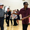 BEN MIKESELL | THE GOSHEN NEWS<br /> Goshen High School freshman Kia Kurtz, right, dances in a conga line with senior Austin Peeler, left, Thursday during the annual life skills prom at in the GHS gymnasium. Students from other high schools were invited to the dance, including Concord, Northridge, NorthWood, Jimtown and Fairfield.