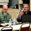 JOHN KLINE | THE GOSHEN NEWS<br /> Kevin Farmwald, a care facilitator and skills trainer at Oaklawn Psychiatric Center, right, speaks during a meeting of the Goshen City Coalition for the Homeless Wednesday at The Window in downtown Goshen. Also pictured is Ross Swihart, director of Faith Mission of Elkhart.