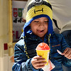 BEN MIKESELL | THE GOSHEN NEWS<br /> Luciano Mingucha, 5, of Goshen, enjoys his free shaved ice from the Kona Ice truck Monday afternoon outside of Interra Credit Union in Goshen. Kona Ice was outside the building for two hours Monday, offering free shaved ice to people finishing their taxes on Tax Day.