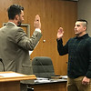 JOHN KLINE | THE GOSHEN NEWS<br /> Goshen Mayor Jeremy Stutsman, left, conducts the swearing-in ceremony for Kevin L. Corona following his promotion from the rank of probationary patrol officer to the rank of patrol officer with the Goshen Police Department during Monday's Goshen Board of Public Works and Safety meeting.
