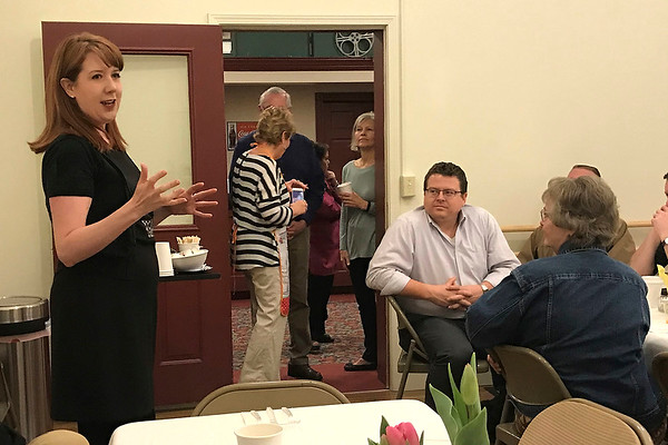 JOHN KLINE | THE GOSHEN NEWS<br /> Amber Burgess, managing director of the Goshen Theater, left, provides an update on her current and future programming goals for the historic venue during a stakeholder breakfast at the theater early Wednesday morning.