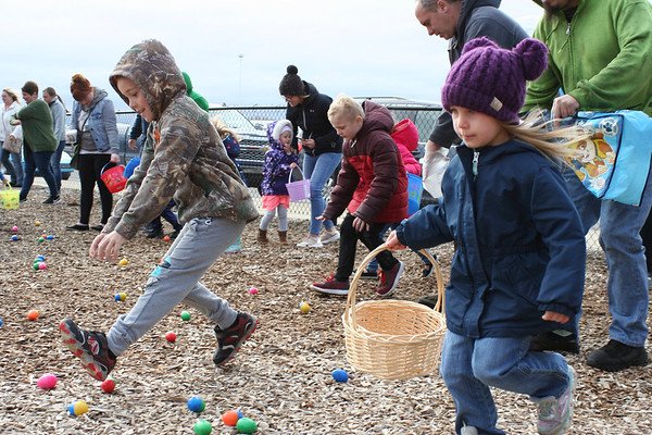 SHEILA SELMAN | THE GOSHEN NEWS<br /> New Paris residents Harlan Wakeland, left, and Briella Holmes, race toward eggs at the start of the New Paris Lions Easter egg hunt Saturday at New Paris Elementary School.