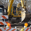 BEN MIKESELL | THE GOSHEN NEWS<br /> Selge Construction crews dig up dirt for new sewer lines Tuesday morning on Fifth Street near the intersection of Madison in Goshen. Multiple intersections along Fifth Street are under construction this week, part of a project expected to conclude May 3, according to the city of Goshen's website.