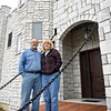 BEN MIKESELL | THE GOSHEN NEWS<br /> John DeWilde and his wife Carolyn stand on the drawbridge in front of their home at 15398 C.R. 22 between Goshen and Middlebury. John and Carolyn wanted the front of their home to resemble a castle when they decided to build in 2017.