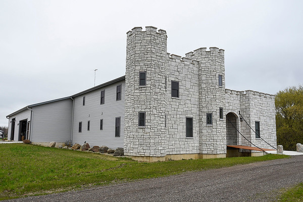 BEN MIKESELL | THE GOSHEN NEWS<br /> The facade of the DeWilde's home on C.R. 22 resembles a castle, complete with a moat and drawbridge, which was completed in December 2017.