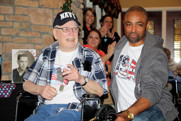 AIMEE AMBROSE | THE GOSHEN NEWS (from left) Veteran James Kehr sits with nurse and personal aide Johnny Williams during a send-off ceremony at Waterford Crossing in Goshen Tuesday ahead of their Honor Flight to Washington, D.C.