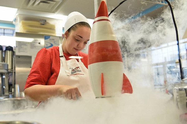 BEN MIKESELL | THE GOSHEN NEWS Bethany Miller, of Nappanee, uses liquid nitrogen to freeze ice cream Tuesday afternoon at Rocket Science Ice Cream in Coppes Commons.