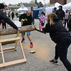 BEN MIKESELL | THE GOSHEN NEWS<br /> People gather in downtown Wakarusa to watch the cross-cut competition Saturday during the Maple Syrup Festival.