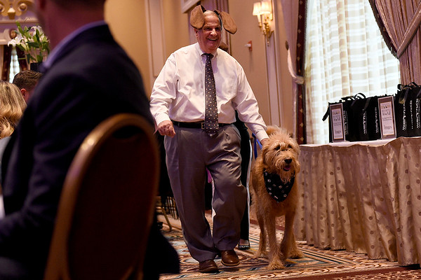 BEN MIKESELL | THE GOSHEN NEWS<br /> Bob Meyers, Granger, is introduced with his dog Pete during the Humane Society of Elkhart County's Best in Show fundraiser Thursday night at the Lerner Theatre.