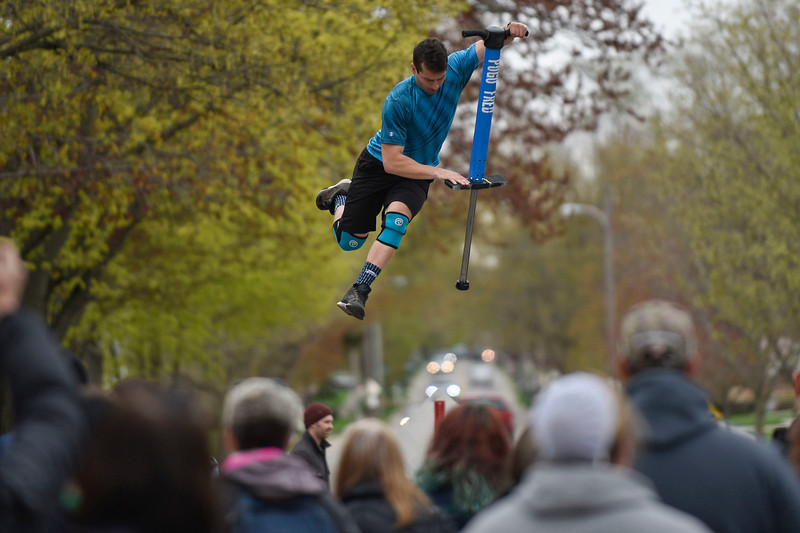 BEN MIKESELL | THE GOSHEN NEWS Boston street performer Pogo Fred soars above the crowd gathered Saturday afternoon at the Maple Syrup Festival in Wakarusa. The annual festival was held Friday, Saturday and Sunday.