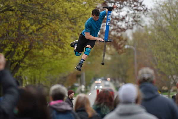 BEN MIKESELL | THE GOSHEN NEWS<br /> Boston street performer Pogo Fred soars above the crowd gathered Saturday afternoon at the Maple Syrup Festival in Wakarusa. The annual festival was held Friday, Saturday and Sunday.