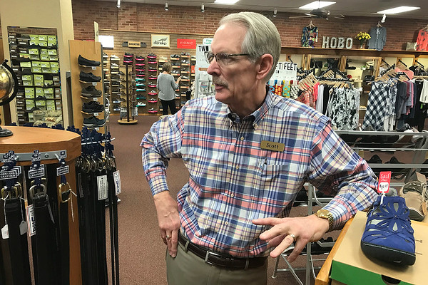 JOHN KLINE | THE GOSHEN NEWS<br /> Scott Woldruff, owner of Woldruff's Footwear & Apparel, 129 S. Main St., Goshen, talks about the state's plan to transfer ownership of Main Street to the city during a visit to his store Wednesday afternoon.