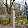 BEN MIKESELL | THE GOSHEN NEWS<br /> Elkhart County Parks landscaper Kyle Strain, left, works on the April section of the calendar garden at DeFries Gardens in New Paris.