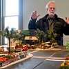 BEN MIKESELL | THE GOSHEN NEWS<br /> Goshen entrepreneur Dave Pottinger stands with a model of downtown Goshen Wednesday morning above Reverie Yarn, Decor & Gifts in Goshen.