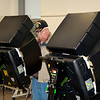 AIMEE AMBROSE | THE GOSHEN NEWS <br /> Calvin Batey, Elkhart, casts his ballot on new voting machines at the Lincoln Center in Elkhart Tuesday, the first day of early voting ahead of the May primary elections.