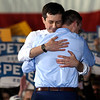 BEN MIKESELL | THE GOSHEN NEWS<br /> South Bend mayor Pete Buttigieg hugs his husband Chasten after announcing he is running in the 2020 presidential election Sunday afternoon at the Studebaker Building 84 in South Bend.