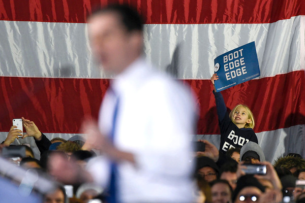 BEN MIKESELL | THE GOSHEN NEWS<br /> A girl holds up a sign while listening to South Bend mayor Pete Buttigieg at the podium Sunday afternoon at the Studebaker Building 84 in South Bend.