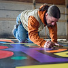 BEN MIKESELL | THE GOSHEN NEWS<br /> Goshen artist Josh Cooper works on a mural in his garage Wednesday afternoon on Wilden Avenue in Goshen. The mural, commissioned by Oaklawn, will be on display at the Elkhart County Courthouse throughout the month of May for Mental Health Awareness Month.