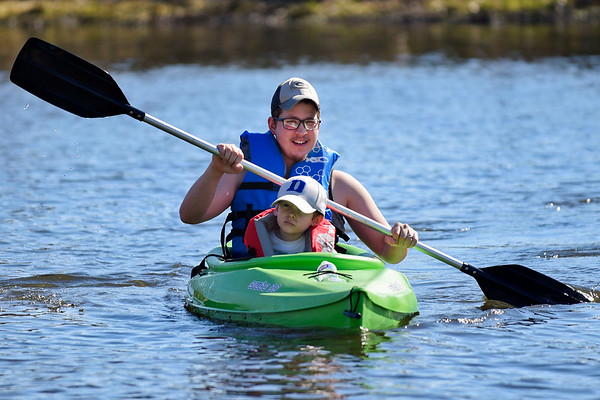 BEN MIKESELL | THE GOSHEN NEWS<br /> Trey Grote, of Goshen, sits with his son Kason, 7, as they kayak down the millrace Monday afternoon near the Goshen Dam Pond. Monday was the family's first chance on the water this season.