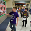 "BEN MIKESELL | THE GOSHEN NEWS<br /> Model Elementary School fifth-grader Austin Hollis, left, presents the Model Citizens of the Month board to teachers visiting Thursday morning from Tyler Elementary in Belleville, Michigan. As a school in the New Tech Network, Model Elementary hosted and gave tours to teachers from Tyler Elementary, who will be making the transition to being a New Tech school next fall. ""We were interested to see what was going on at each grade level and get ideas to take back to Michigan,"" Tyler ElementaryPrinicpal Aleisa Pitt said."
