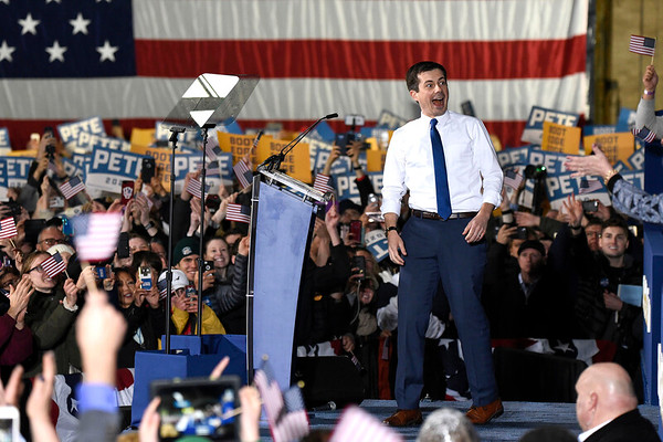 BEN MIKESELL | THE GOSHEN NEWS<br /> South Bend mayor Pete Buttigieg smiles as he walks on stage to announce his running in the 2020 presidential election Sunday afternoon at the Studebaker Building 84 in South Bend.