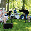 AIMEE AMBROSE | THE GOSHEN NEWS <br /> Members of the Backyard Brass band play jazz, providing entertainment during an event to celebrate the 100th anniversary of Rogers Park Saturday.