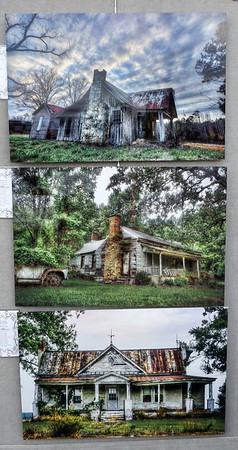 DENISE FEDOROW | THE GOSHEN NEWS<br /> This display shows some old farmhouses and country homes that have been abandoned and are in disrepair. Kyle Wilson of Left Behind Photography brings beauty to these once stately structures. This is Wilson's second year at the Amish Acres Arts & Crafts Festival.