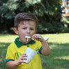 AIMEE AMBROSE | THE GOSHEN NEWS <br /> Micah Romao, 2, digs into some ice cream while enjoying a back-to-school party at The Post, 301 E. Lincoln Ave., sponsored by Harvest Community Church Saturday.