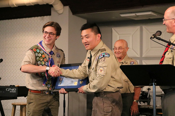 SHEILA SELMAN | THE GOSHEN NEWS<br /> Eagle Scout Wyatt Hart shakes hands with mentor Benjamin Rogers Sunday afternoon at LifeSpring Church in Goshen upon receiving a plaque for his accomplishment.