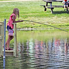 Roger Schneider | The Goshen News<br /> Kyre Leman, 10, of Medaryville, Ind., uses a stick and line to fish from a dock at Amish Acres in Nappanee Thursday. Leman was one of thousands of people who attended the opening day of the Amish Acres Arts & Crafts Festival. The festival runs through Sunday. More photos from the event will be published on Page C1 Saturday.