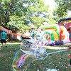 AIMEE AMBROSE | THE GOSHEN NEWS <br /> (from left) Jane Graber, 8, and Ruby Graber, 4, make bubbles while playing at a back-to-school party at The Post, 301 E. Lincoln Ave., sponsored by Harvest Community Church Saturday.