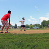 Roger Schneider | The Goshen News<br /> Micah Kerlin prepares to swing at a pitch at Rogers Park Wednesday afternoon. Kerlin, Damian Hernandez, catching and Zachary Schmucker, pitching, are members of a Forest River intramural softball team that was practiciing. The park has provided baseball and softball teams a place to practice and play for many years. The park's 100th anniversary will be celebrated Saturday.