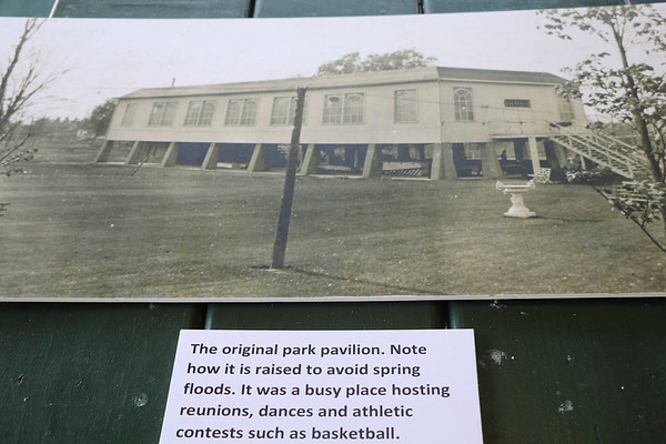 AIMEE AMBROSE | THE GOSHEN NEWS <br /> A poster-sized photograph with a placard shows the original pavilion that stood on pillars at Rogers Park. The photo was among those on display during an event to celebrate the park's 100th anniversary Saturday.