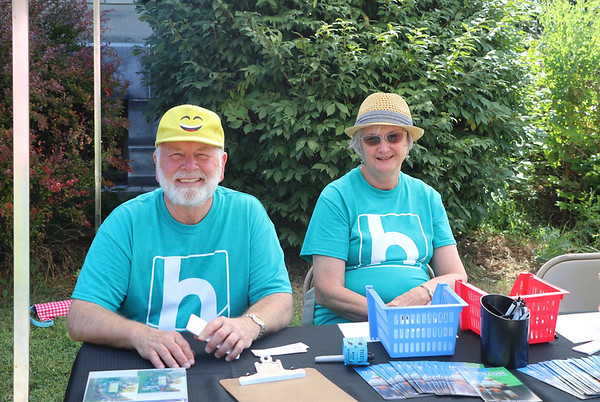 AIMEE AMBROSE | THE GOSHEN NEWS <br /> Tim and Dore Peterson, Goshen, sit at an information booth while attending a back-to-school party at The Post, 301 E. Lincoln Ave., sponsored by Harvest Community Church Saturday.