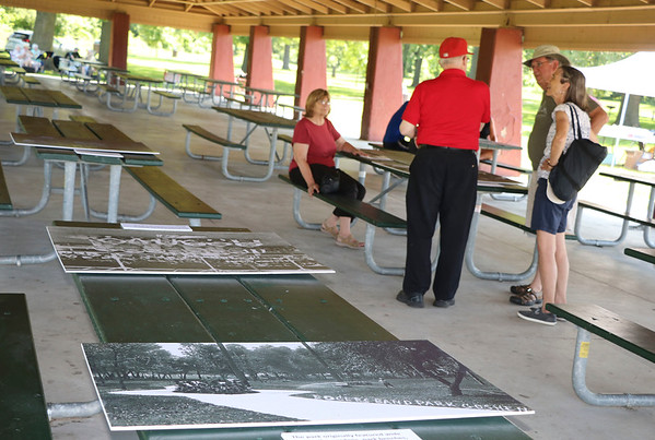 AIMEE AMBROSE | THE GOSHEN NEWS <br /> A few people chat about the history of Rogers Park while old photographs were on display in the pavilion along Chicacgo Avenue during the park's 100th anniversary event Saturday.